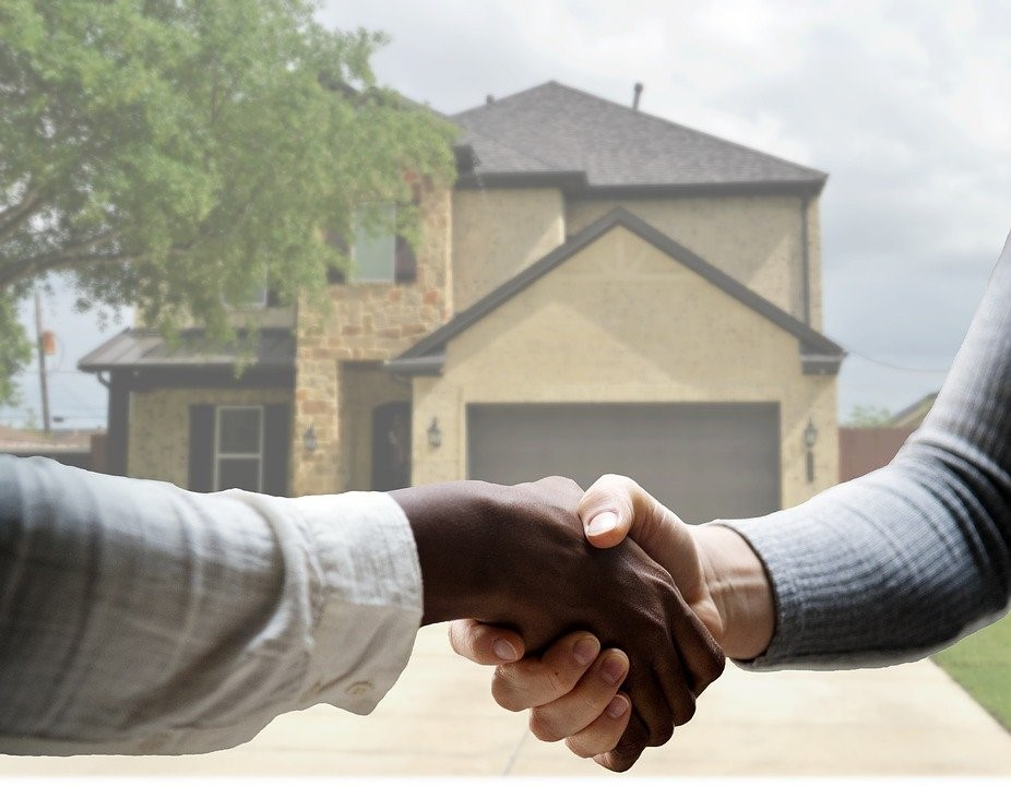 Home buyer and seller shaking hands