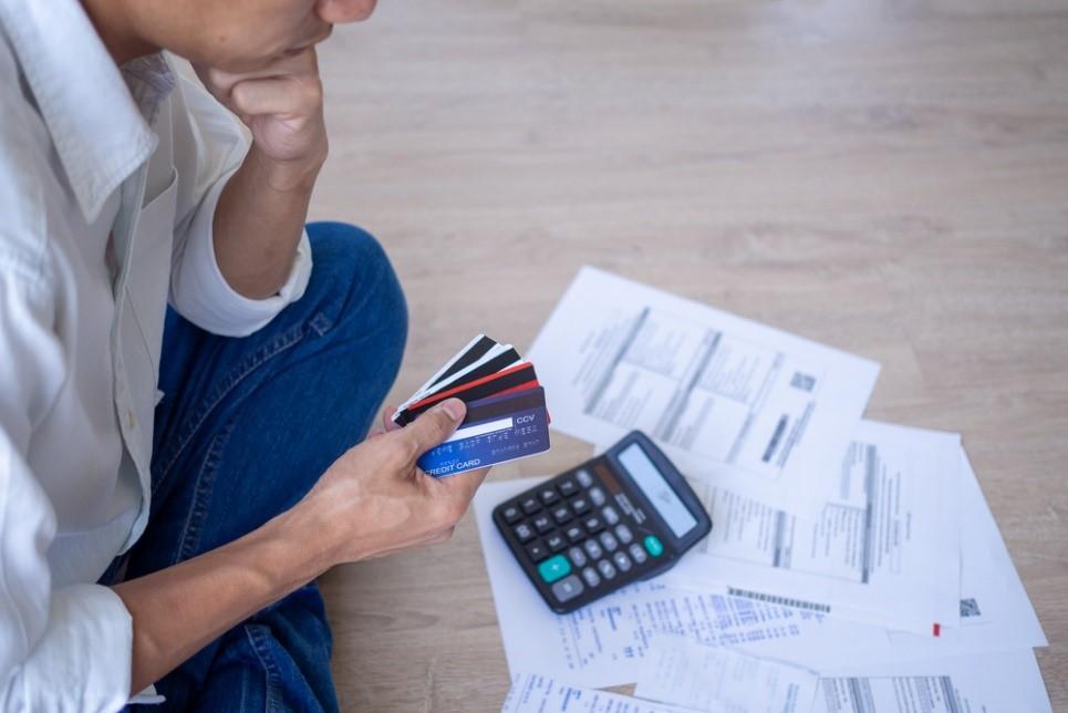 Man calculating credit cards bill