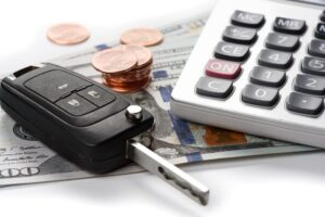 car key with dollars and calculator